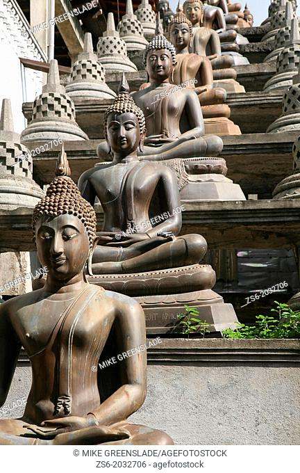 Statues of the Buddha in the lotus position, Gangaramaya Buddhist Temple, Colombo, Sri Lanka