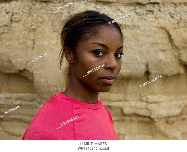 An apprehensive young woman looking sideways