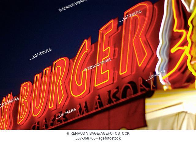 Neon hamburger sign. Riviera. France
