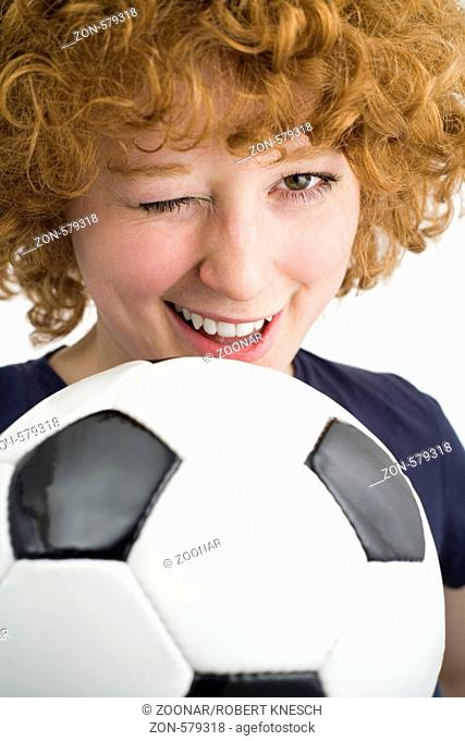 Redhead with football