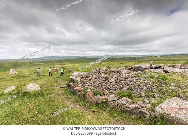 Armenia, Sisian, Zorats Karer, Carahunge, arranged stones dating back to 3000BC, with visitors, NR