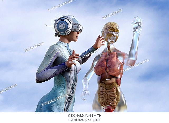 Woman viewing organs of transparent woman in virtual reality