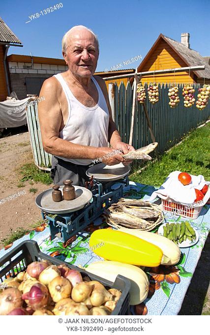 Old Street Vendor Selling Fresh Vegetables and Fish in Kasepää Russian Old Believers Village, Estonia, Europe