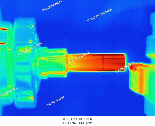 Thermal image of turning a part on a lathe, showing heat buildup on cutting tool