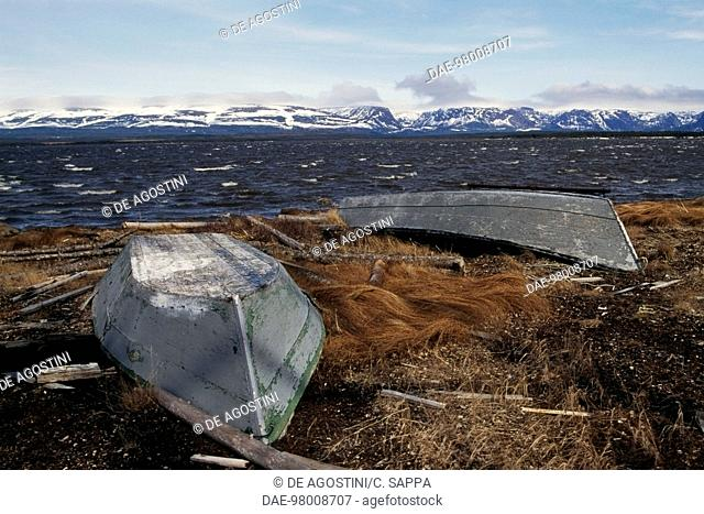 Overturned boats, the background Long Range mountains, near Port Aux Basques, Newfoundland, Canada