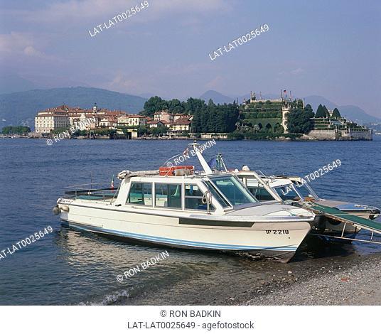 Lake Maggiore. Boats. Castle. Borromean Island of Isola Bella behind