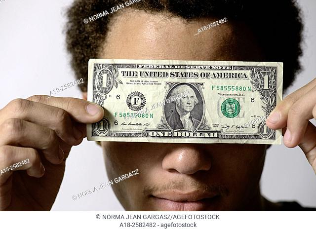 A young man with a one dollar bill