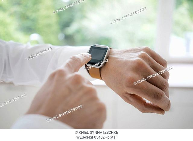 Man pointing at his smartwatch