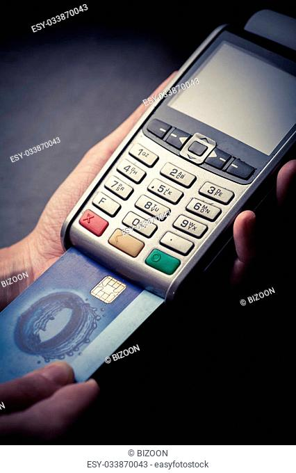 Color image of a POS and credit cards