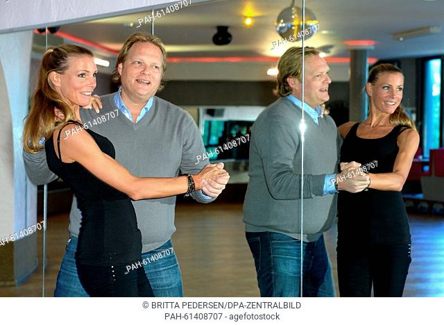 Television chef Bjoern Freitag (R) and his wife and model Anna Freitag smile as they perform during a practice session for the television celebrity dance show...