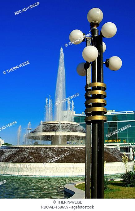 Fountain and lantern in front of World Trade complex Ashgabat Turkmenistan