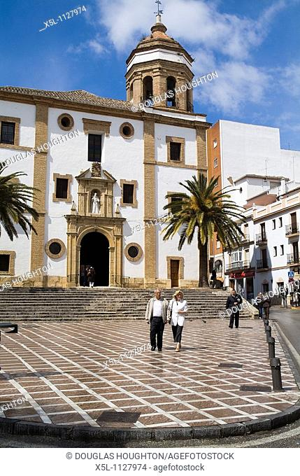 RONDA SPAIN couple walking across plaza Iglesia de la Merced convent