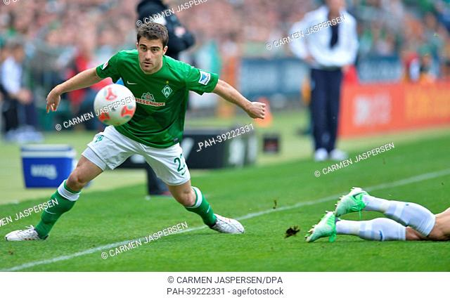 Bremen's Sokratis controls the ball during the match Werder Bremen vs TSG 1899 Hoffenheim at the Weser Stadion in Bremen, Germany, 04 May 2013