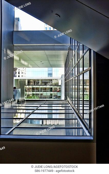 Architectural Patterns - Looking through a high floor window at a neighboring office building
