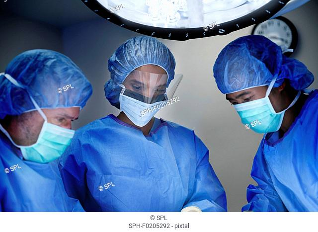 Doctors performing operation