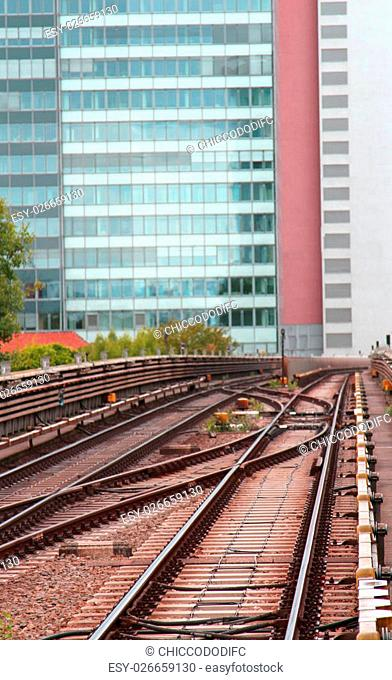 buildings and the rails of the train for commuter transport in the workplace