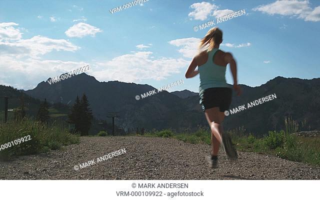 woman running down a trail