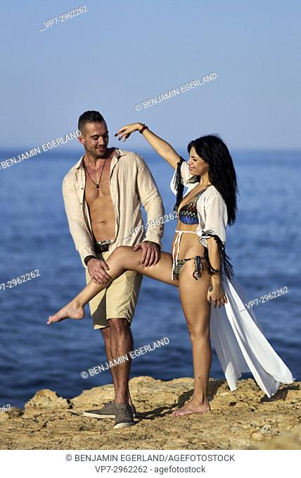 happy couple playing together at Mediterranean beach. Greek ethnicity. In holiday destination Hersonissos, Crete, Greece