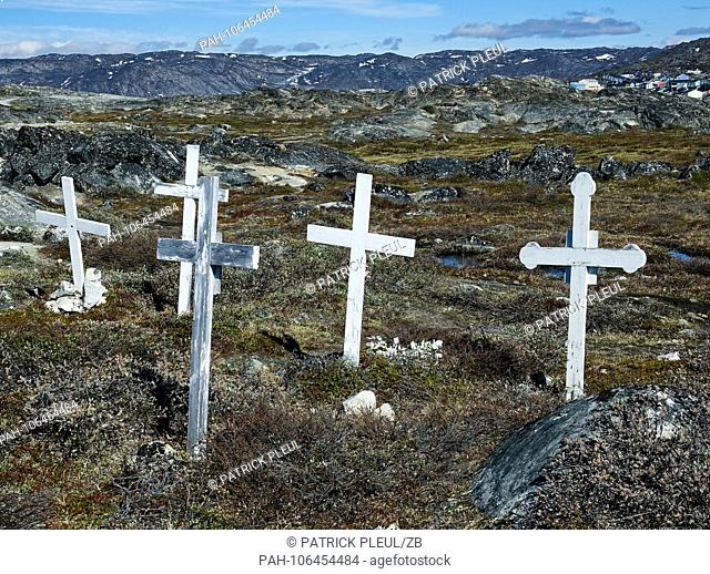 24.06.2018, Gronland, Denmark: A cemetery on the edge of the coastal town of Ilulissat in western Greenland. The city is located on the Ilulissat Icefjord
