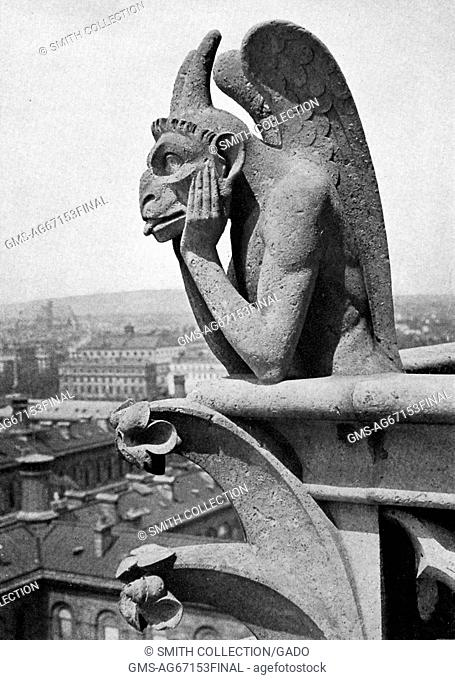 Close up of a leering gargoyle from the Cathedral of Notre-Dame, picture by Donald McLeish, Paris, France, July, 1922