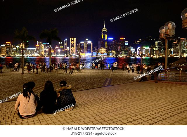 Hong Kong, China, Asia. Hong Kong Kowloon. Nightlife at the the Hong Kong Cultural Center with the skyline of Hong Kong Island in the background
