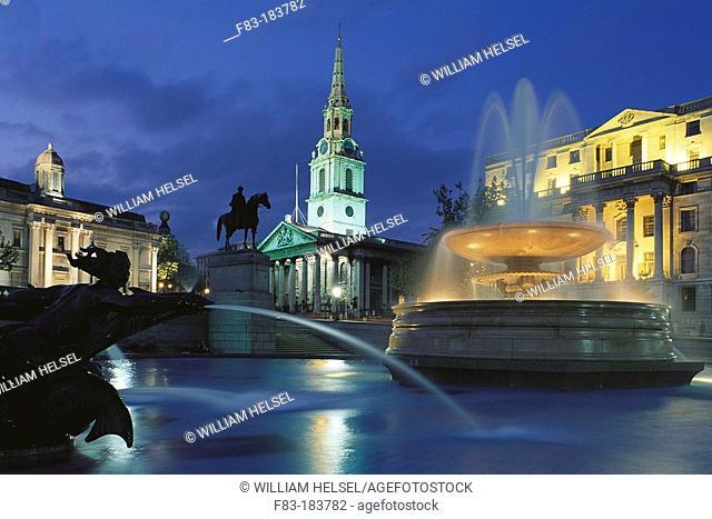 Fountain at Trafalgar Square, Saint Martin in the Fields church in background. London. England