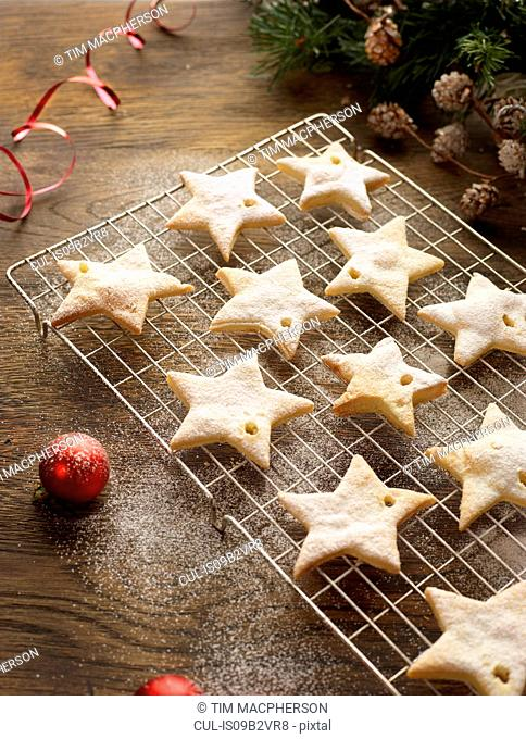 Christmas star biscuits on cooling rack
