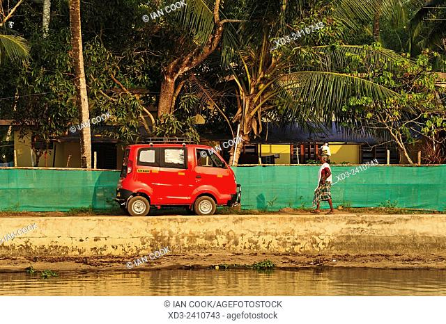 red Tata van beside backwaters between Kollam and Cochin, Kerala, India
