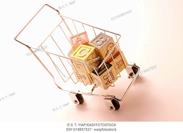 Alphabet cubes in shopping trolley