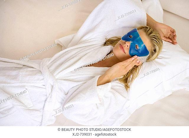 Woman relaxing with eye mask