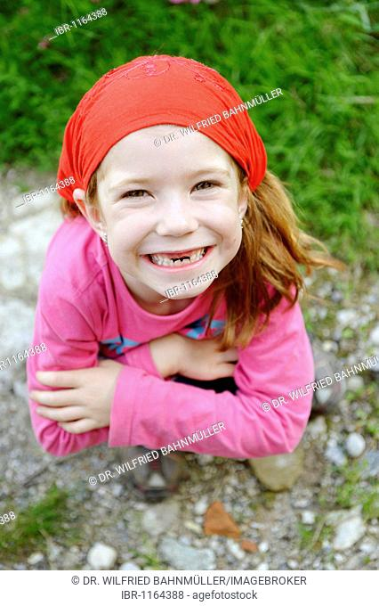Little girl with a tooth gap, top incisor teeth are missing