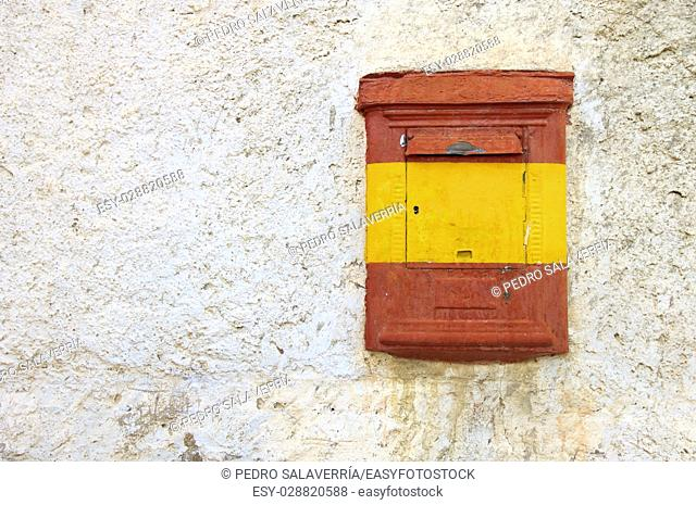 View of an old mail box painted with the flag of Spain