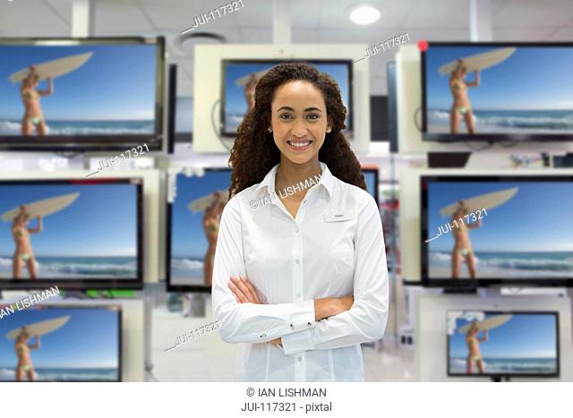 Portrait Of Female Sales Assistant In Television Store
