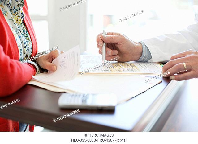 doctor reviewing requisition with senior patient