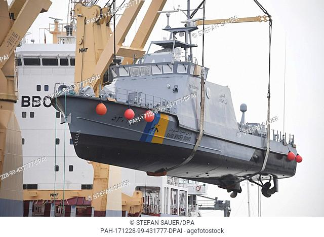A coast guard boat for Saudi Arabia is loaded on to a transport ship in the harbour of Mukran near Sassnitz, Germany, 28 December 2017