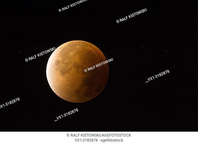 Lunar Eclipse, Red supermoon, Blood moon, red orange full moon with sparkling stars, 28th September 2015