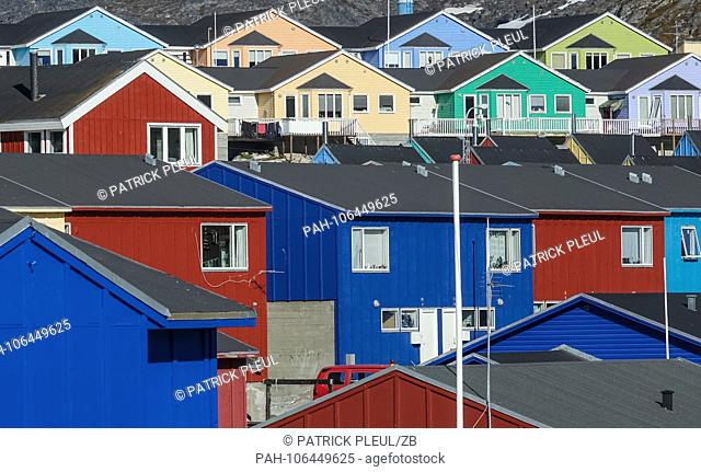 27.06.2018, Gronland, Denmark: Colorful houses of the coastal town of Ilulissat in western Greenland. The city is located on the Ilulissat Icefjord