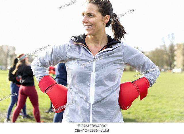 Portrait confident woman boxing in park