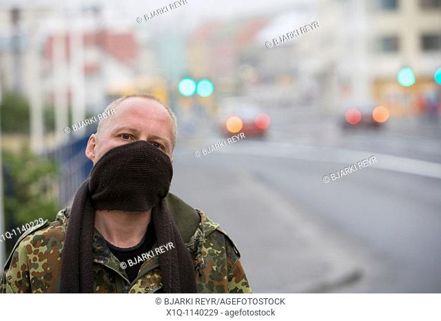 Reykjavik - Iceland, June 4, 2010 : Volcanic ash from Eyjafjallajokull is still blowing around south and southwest Iceland  Einar is covering his mouth with a...