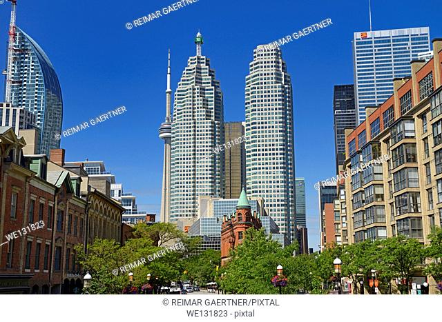 Gooderham Flatiron building with financial district bank towers L tower and CN tower Toronto