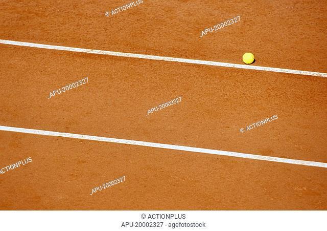 Tennis ball on a clay tennis court