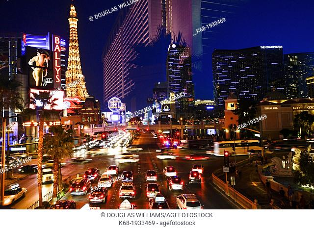 traffic at night on The Strip, Las Vegas Boulevard South, and a reflection of a hotel