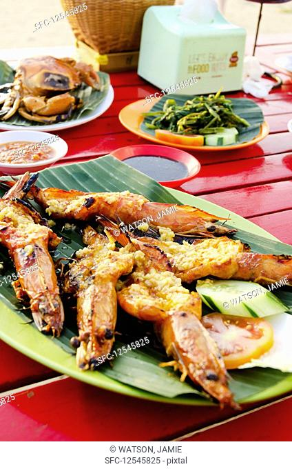 Spicy butterflied king prawns with chili and Ginger in Bali