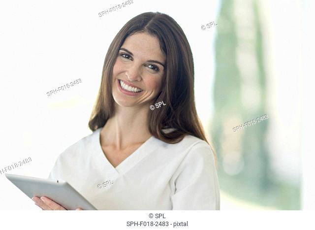 Female medical professional smiling towards camera, portrait