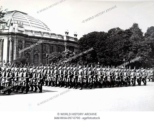 Photograph of German troops marching near the Grande Palais, in Paris, during the German occupation of France in World War Two. Dated 20th Century