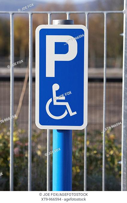 post with disabled parking sign in a car park in the uk ireland