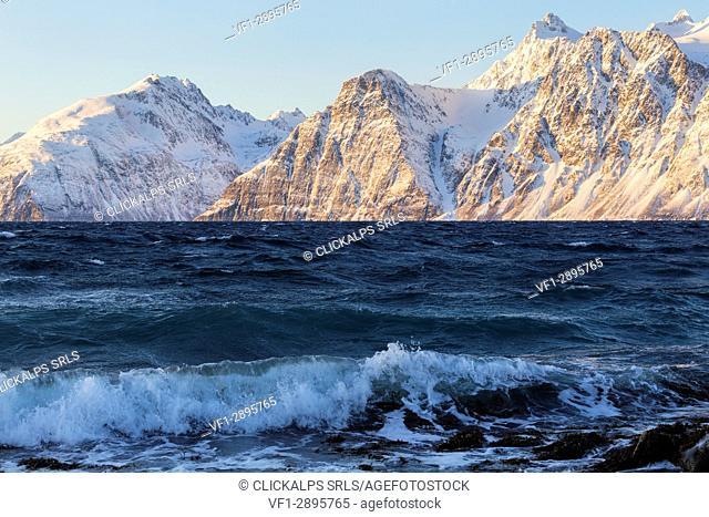 The waves breaking on the windy coast. Spaknesora naturreservat, Djupvik, Lyngenfjord, Lyngen Alps, Troms, Norway, Lapland, Europe