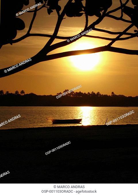 one canoe anchored at jericoacoara beach sunset