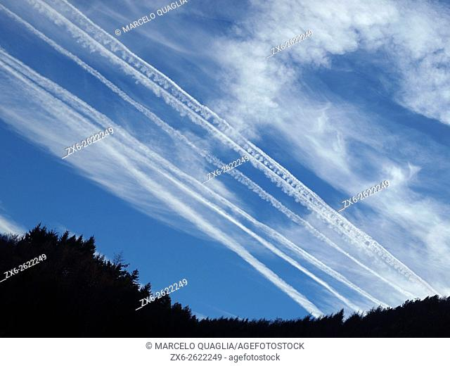 Airplane clouds at dusk. Montseny Natural Park. Barcelona province, Catalonia, Spain