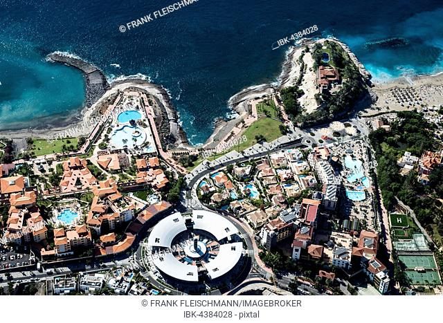 Seaside resort with beach and promenade by the sea, Playa del Duque, townscape with hotels and shopping malls, tourist area, south coast, Costa Adeje, Tenerife